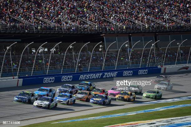 Ty Dillon driver of the GEICO Chevrolet leads a pack of cars during the Monster Energy NASCAR Cup Series Alabama 500 at Talladega Superspeedway on...