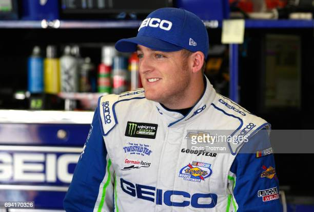 Ty Dillon driver of the GEICO Chevrolet stands in the garage area during practice for the Monster Energy NASCAR Cup Series Axalta presents the Pocono...