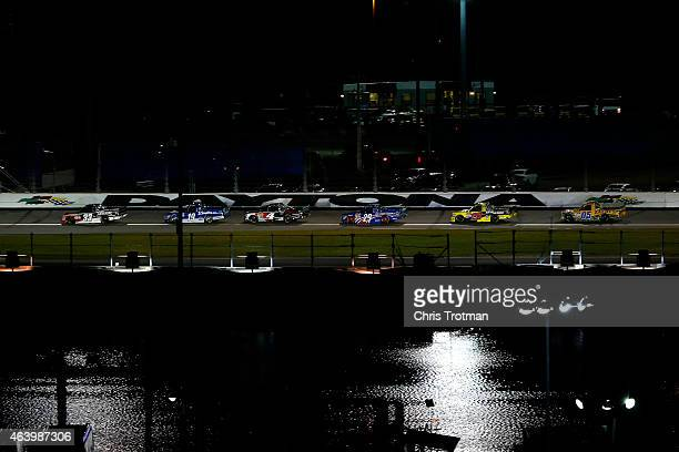 Ty Dillon driver of the Rheem/Gemaire Chevrolet leads a pack of trucks during the NASCAR Camping World Truck Series NextEra Energy Resources 250 at...