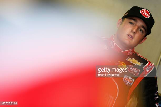 Ty Dillon driver of the Rheem/Johns Manville Chevrolet stands in the garage area during practice for the NASCAR XFINITY Series Lilly Diabetes 250 at...