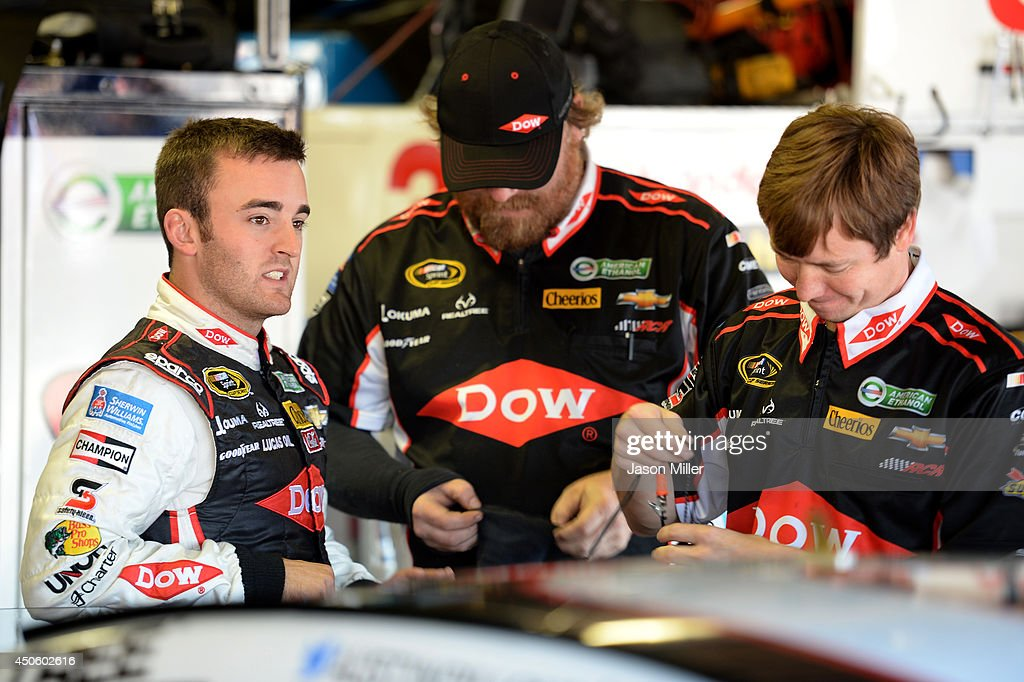 Ty Dillon, driver of the #3 Wesco Chevrolet, left, talks with crew members in the garage area during practice for the NASCAR Sprint Cup Series Quicken Loans 400 at Michigan International Speedway on June 14, 2014 in Brooklyn, Michigan.