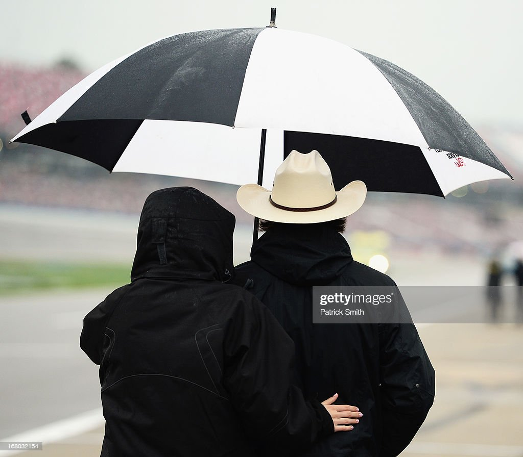 Ty Dillon, driver of the #33 Wesco Chevrolet, walks down pit road as rain delayed the start of the NASCAR Nationwide Series Aaron's 312 at Talladega Superspeedway on May 4, 2013 in Talladega, Alabama.