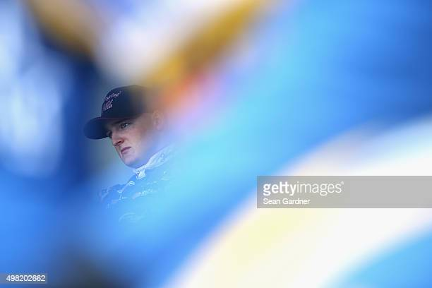 Ty Dillon driver of the Yuengling Light Lager Chevrolet looks on during prerace ceremonies for the NASCAR XFINITY Series Ford EcoBoost 300 at...
