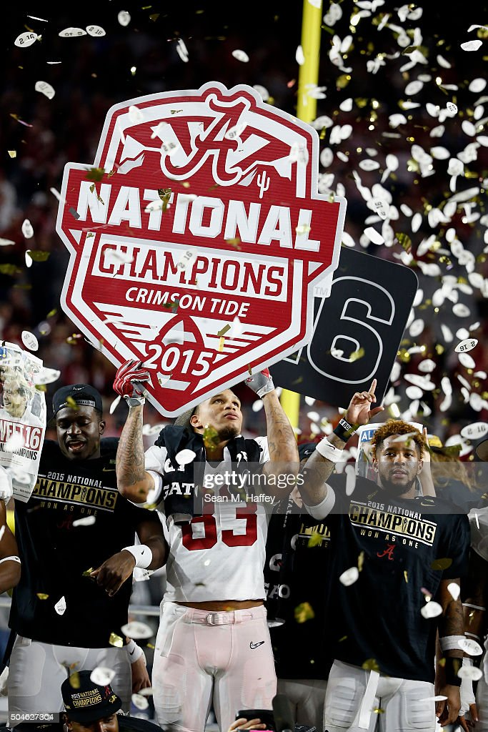 Ty Flournoy-Smith #83 of the Alabama Crimson Tide celebrates with a sign that reads, 'Alabama Crimson Tide National Champions' after defeating the Clemson Tigers in the 2016 College Football Playoff National Championship Game at University of Phoenix Stadium on January 11, 2016 in Glendale, Arizona. The Crimson Tide defeated the Tigers with a score of 45 to 40.