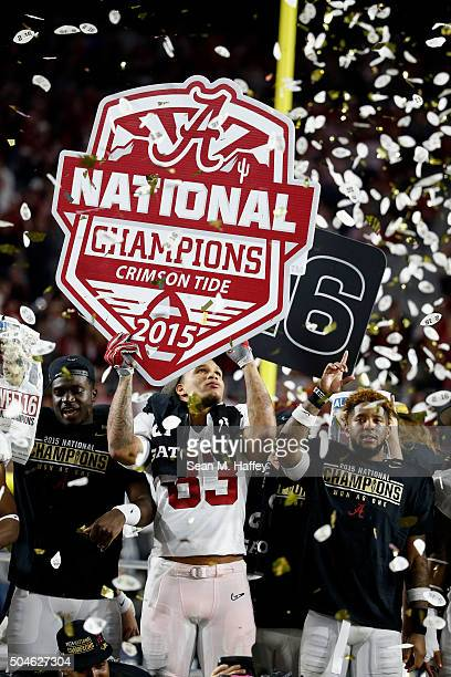 Ty FlournoySmith of the Alabama Crimson Tide celebrates with a sign that reads 'Alabama Crimson Tide National Champions' after defeating the Clemson...