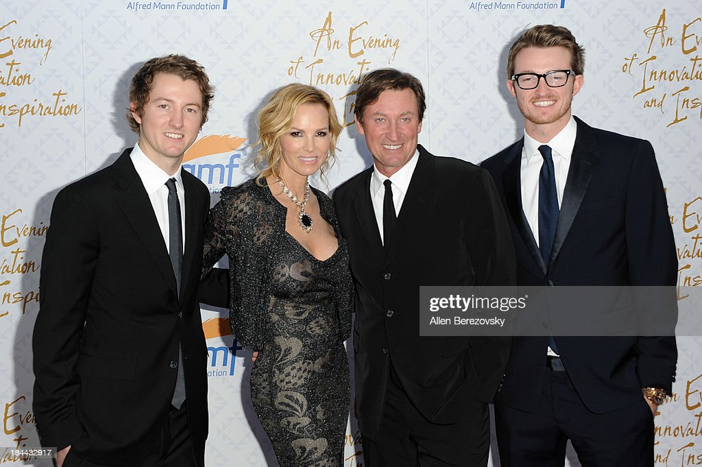 Ty Gretzky, Janet Gretzky, Wayne Gretzky and Trevor Gretzky attend the 10th annual Alfred Mann Foundation Gala at 9900 Wilshire Blvd on October 13, 2013 in Beverly Hills, California.