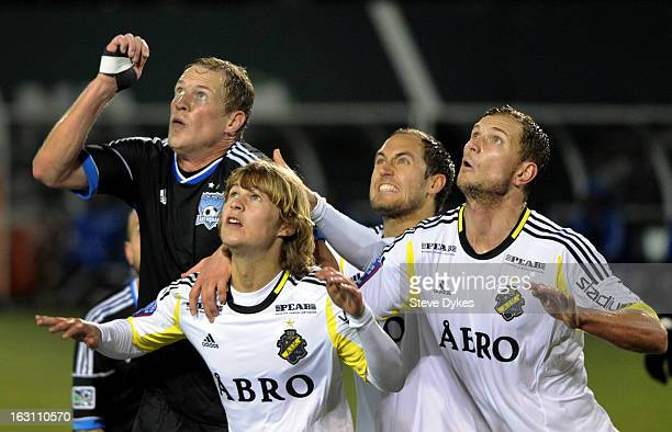 Ty Harden of the San Jose Earthquakes anticipates a corner kick with Sam Lundholm Niklas Backman and Robert Ahman Persson of AIK during the second...