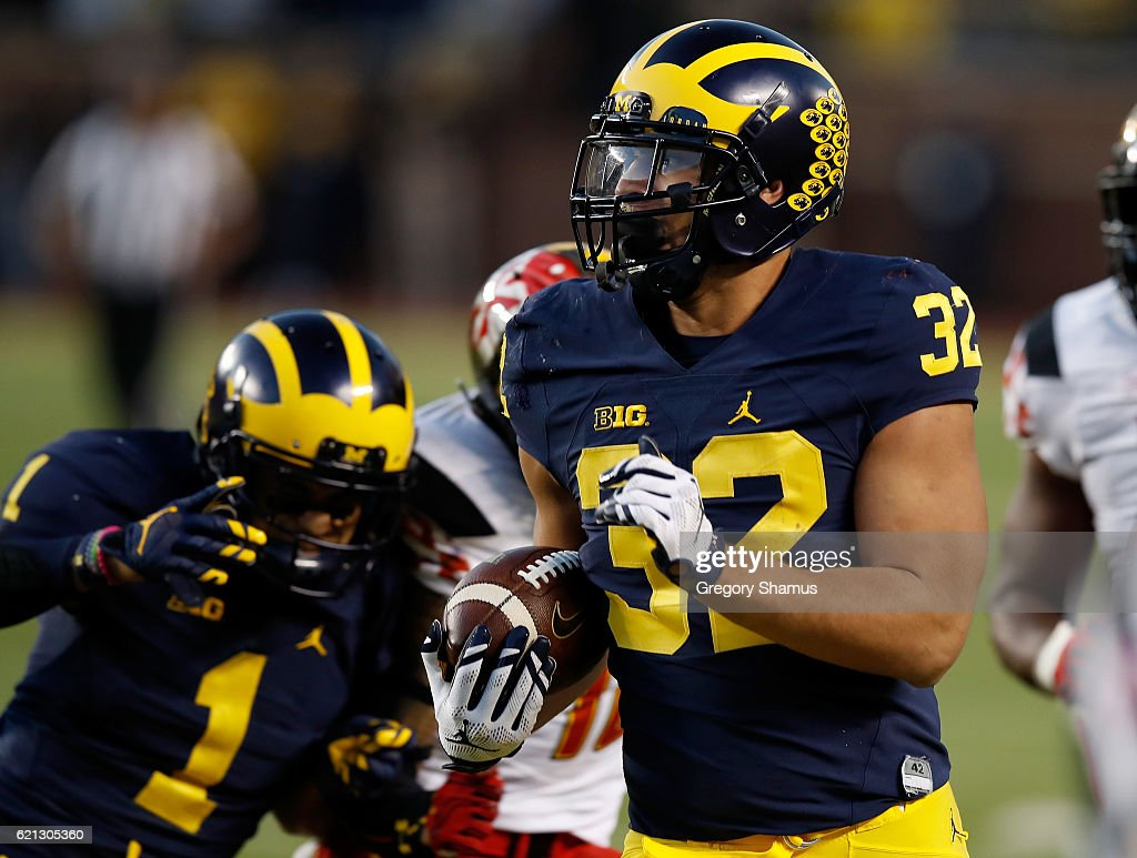 Ty Isaac #32 of the Michigan Wolverines looks for extra yards during a second half run while playing the Maryland Terrapins on November 5, 2016 at Michigan Stadium in Ann Arbor, Michigan. Michigan won the game 59-3.