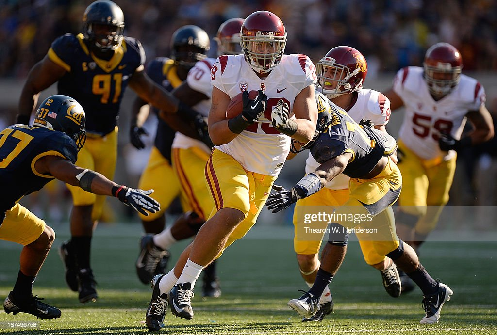 Ty Isaac #29 of the USC Trojans carries the ball against the California Golden Bears during the third quarter at California Memorial Stadium on November 9, 2013 in Berkeley, California. The Trojans won the game 62-28.