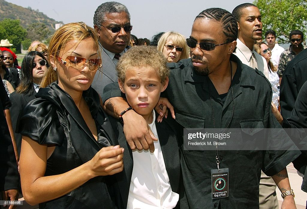 Ty James, Tazman James and Rick James Jr., children of the late recording artist Rick James, attend his funeral service at Forest Lawn Cemetery on August 12, 2004 in Los Angeles, California. (Photo by Frederick M. Brown/Getty Images).