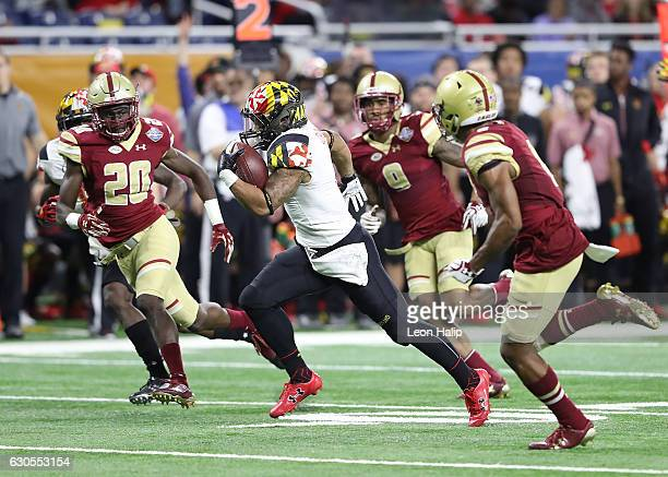 Ty Johnson of the Maryland Terrapins runs 30 yards for a second quarter touchdown during the game against the Boston College Eagles at Ford Field on...