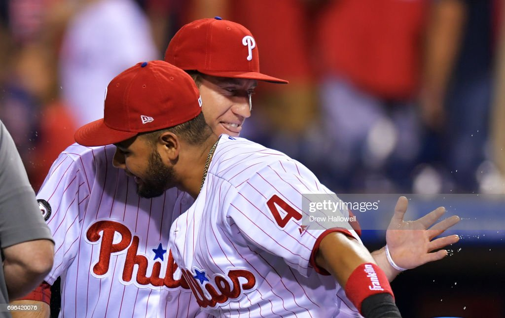 Ty Kelly #15 and Andres Blanco #4 of the Philadelphia Phillies celebrate after beating the Boston Red Sox 1-0 at Citizens Bank Park on June 15, 2017 in Philadelphia, Pennsylvania.