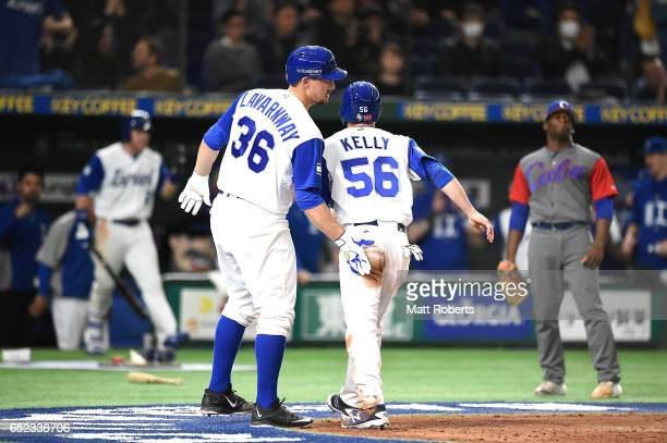 Ty Kelly of Israel is celebrated by Ryan Lavarnway after scoring as Zach Borenstein hits a RBI single grounder to right fielder in the sixth inning...