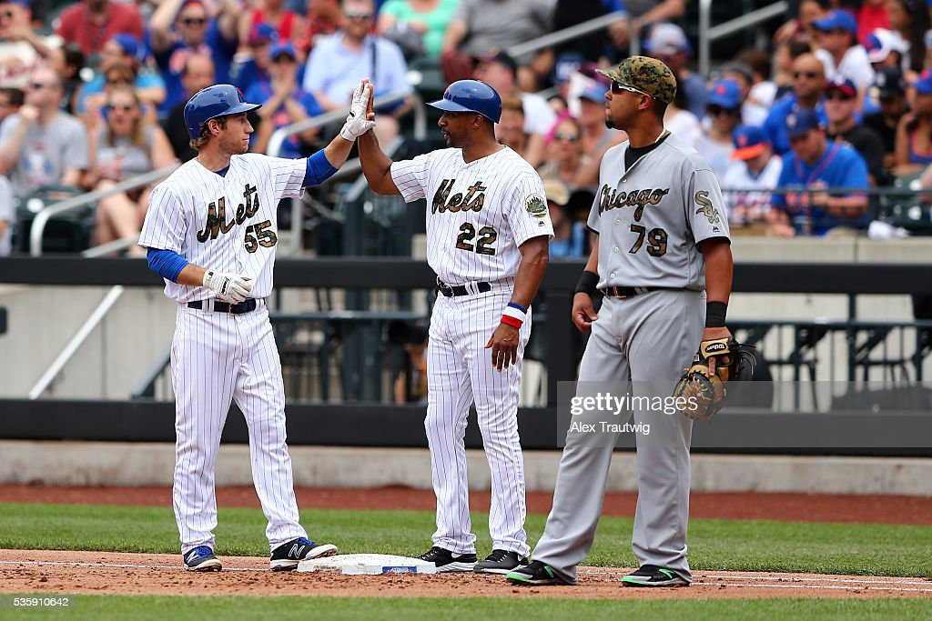 Ty Kelly #55 of the New York Mets is congratulated by first base coach <a gi-track='captionPersonalityLinkClicked' href=/galleries/search?phrase=Tom+Goodwin&family=editorial&specificpeople=184551 ng-click='$event.stopPropagation()'>Tom Goodwin</a> #22 after getting his first career Major League hit in the fifth inning during the game against the Chicago White Sox at Citi Field on Monday, May 30, 2016 in the Queens borough of New York City.