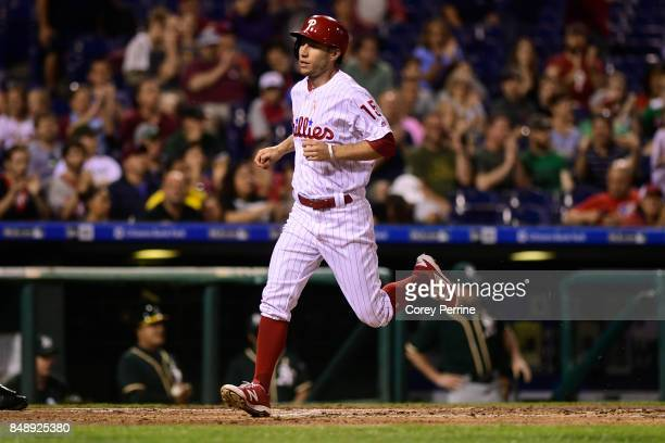 Ty Kelly of the Philadelphia Phillies is batted in as he crosses home plate against the Oakland Athletics during the third inning at Citizens Bank...