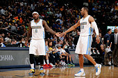 Ty Lawson and Arron Afflalo of the Denver Nuggets celebrates during a game against the Oklahoma City Thunder on October 8 2014 at the Pepsi Center in...