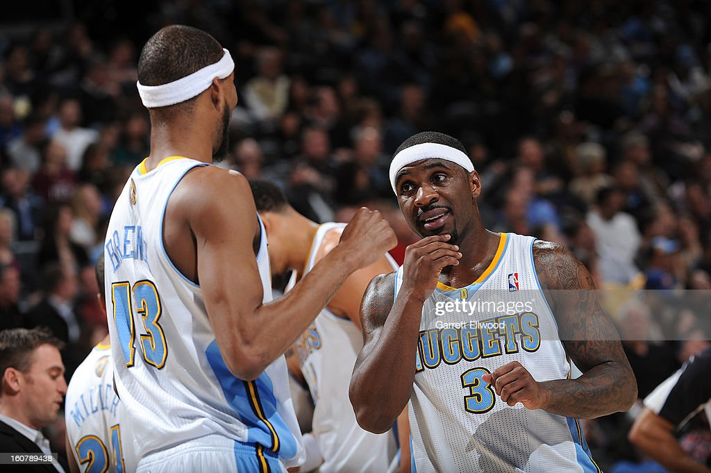 Ty Lawson #3 and Corey Brewer #13 of the Denver Nuggets have a conversation versus the Milwaukee Bucks on February 5, 2013 at the Pepsi Center in Denver, Colorado.