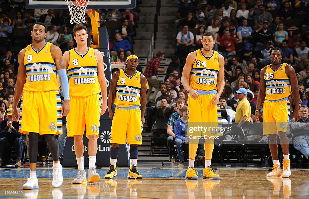 <a gi-track='captionPersonalityLinkClicked' href=/galleries/search?phrase=Ty+Lawson&family=editorial&specificpeople=4024882 ng-click='$event.stopPropagation()'>Ty Lawson</a> #3 and the Denver Nuggets stand on court during the game between the New Orleans Hornets and the Denver Nuggets on November 25, 2012 at the Pepsi Center in Denver, Colorado.