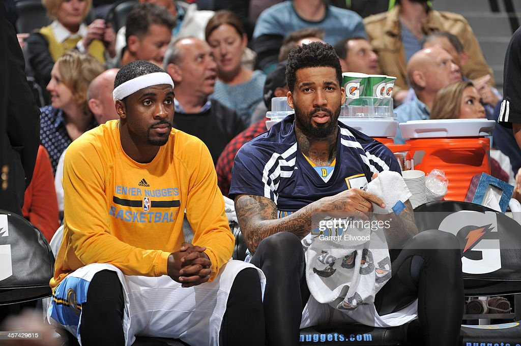 Ty Lawson #3 and Wilson Chandler #21 of the Denver Nuggets sit on the bench during the game against the Los Angeles Lakers on November 13, 2013 at the Pepsi Center in Denver, Colorado.