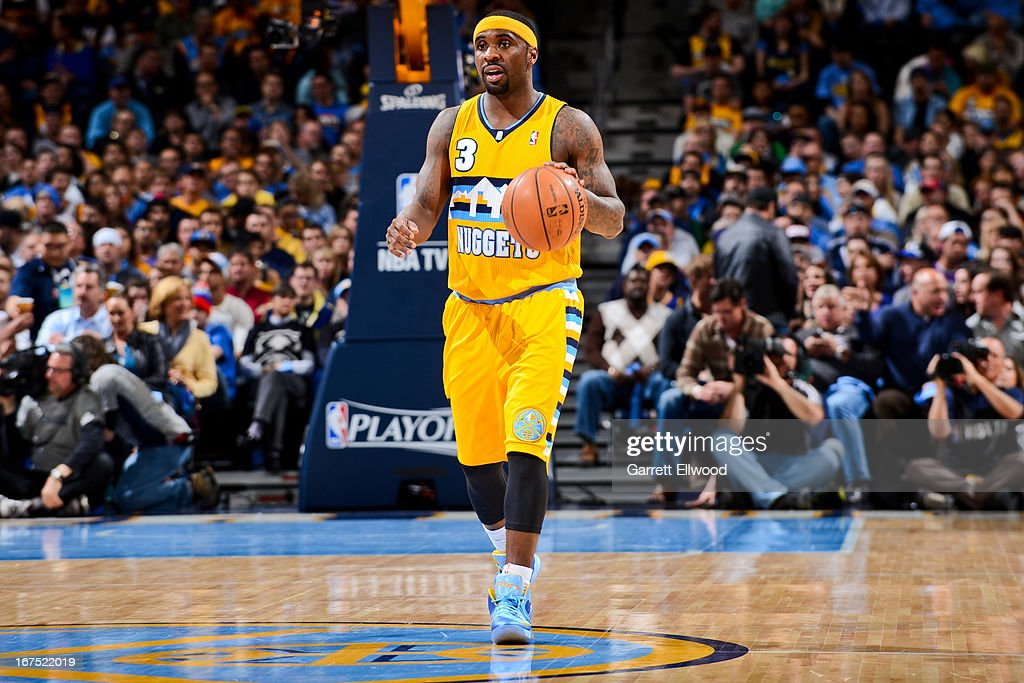 <a gi-track='captionPersonalityLinkClicked' href=/galleries/search?phrase=Ty+Lawson&family=editorial&specificpeople=4024882 ng-click='$event.stopPropagation()'>Ty Lawson</a> #3 of the Denver Nuggets advances the ball against the Golden State Warriors in Game Two of the Western Conference Quarterfinals during the 2013 NBA Playoffs on April 23, 2013 at the Pepsi Center in Denver, Colorado.