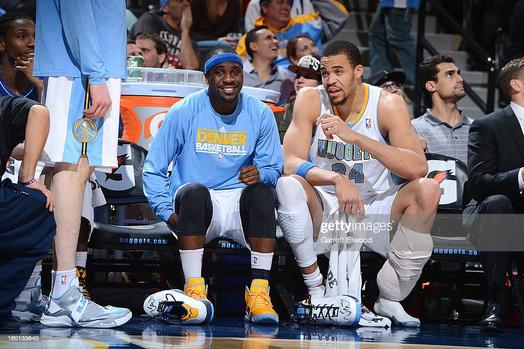 Ty Lawson #3 of the Denver Nuggets and JaVale McGee #34 of the Denver Nuggets are seen smiling from the bench during the game between the Sacramento Kings and the Denver Nuggets on January 26, 2013 at the Pepsi Center in Denver, Colorado.