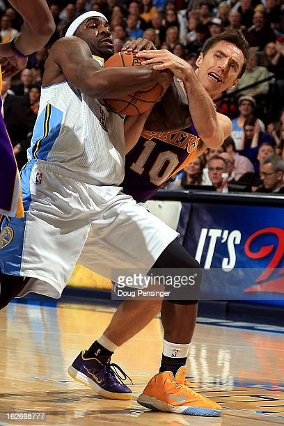 Ty Lawson of the Denver Nuggets and Steve Nash of the Los Angeles Lakers battle for control as a jump ball is called at the Pepsi Center on February...