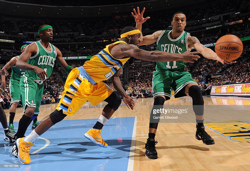 Ty Lawson #3 of the Denver Nuggets battles for a loose ball against Courtney Lee #11 of the Boston Celtics on February 19, 2013 at the Pepsi Center in Denver, Colorado.