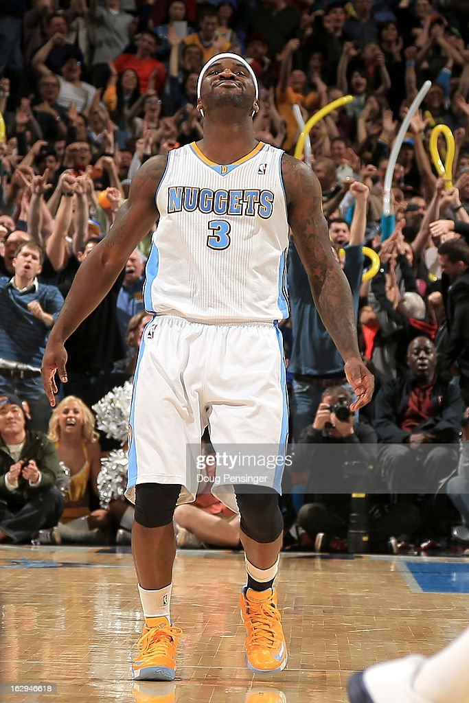 Ty Lawson #3 of the Denver Nuggets celebrates after hitting the game winning shot against the Oklahoma City Thunder in the finals seconds at the Pepsi Center on March 1, 2013 in Denver, Colorado. The Nuggets defeated the Thunder 105-103.