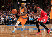 Ty Lawson of the Denver Nuggets controls the ball against Aaron Brooks of the Chicago Bulls at Pepsi Center on November 25 2014 in Denver Colorado...