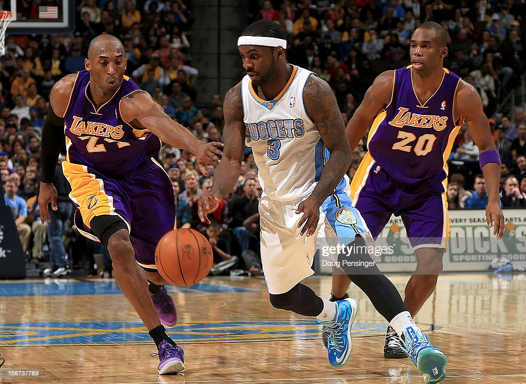 Ty Lawson #3 of the Denver Nuggets controls the ball against Kobe Bryant #24 of the Los Angeles Lakers and Jodie Meeks #20 of the Los Angeles Lakers at Pepsi Center on December 26, 2012 in Denver, Colorado. The Nuggets defeated the Lakers 126-114.
