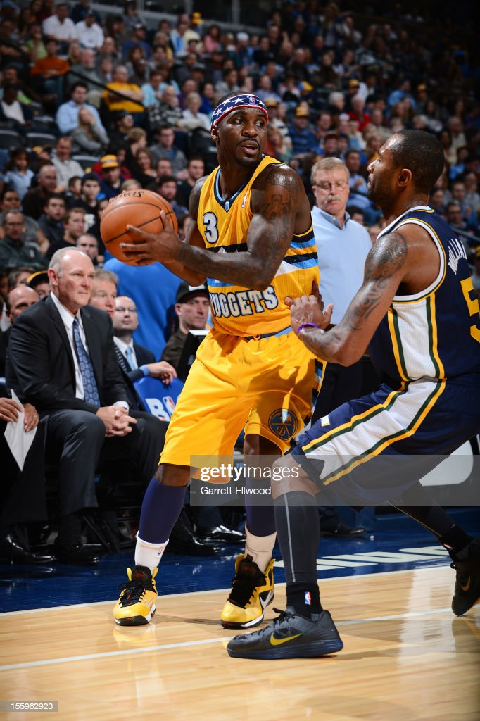 <a gi-track='captionPersonalityLinkClicked' href=/galleries/search?phrase=Ty+Lawson&family=editorial&specificpeople=4024882 ng-click='$event.stopPropagation()'>Ty Lawson</a> #3 of the Denver Nuggets controls the ball against Mo Williams #5 of the Utah Jazz on November 9, 2012 at the Pepsi Center in Denver, Colorado.