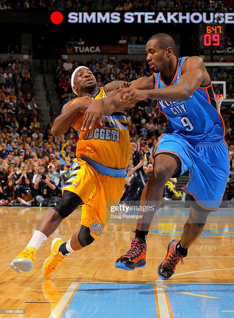 Ty Lawson #3 of the Denver Nuggets controls the ball against Serge Ibaka #9 of the Oklahoma City Thunder at the Pepsi Center on January 20, 2013 in Denver, Colorado. The Nuggets defeated the Thunder 121-118 in overtime.