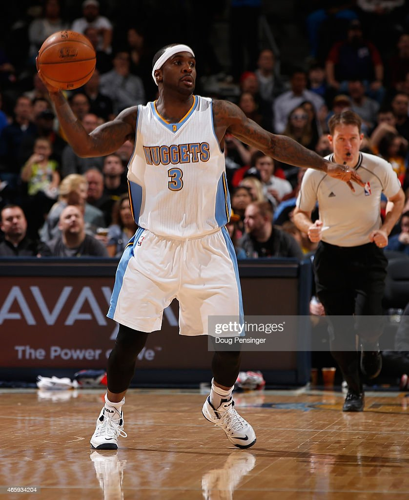 Ty Lawson of the Denver Nuggets controls the ball against the Atlanta Hawks at Pepsi Center on March 11 2015 in Denver Colorado The Nuggets defeated...