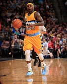 Ty Lawson of the Denver Nuggets controls the ball against the Chicago Bulls at Pepsi Center on November 25 2014 in Denver Colorado The Nuggets...