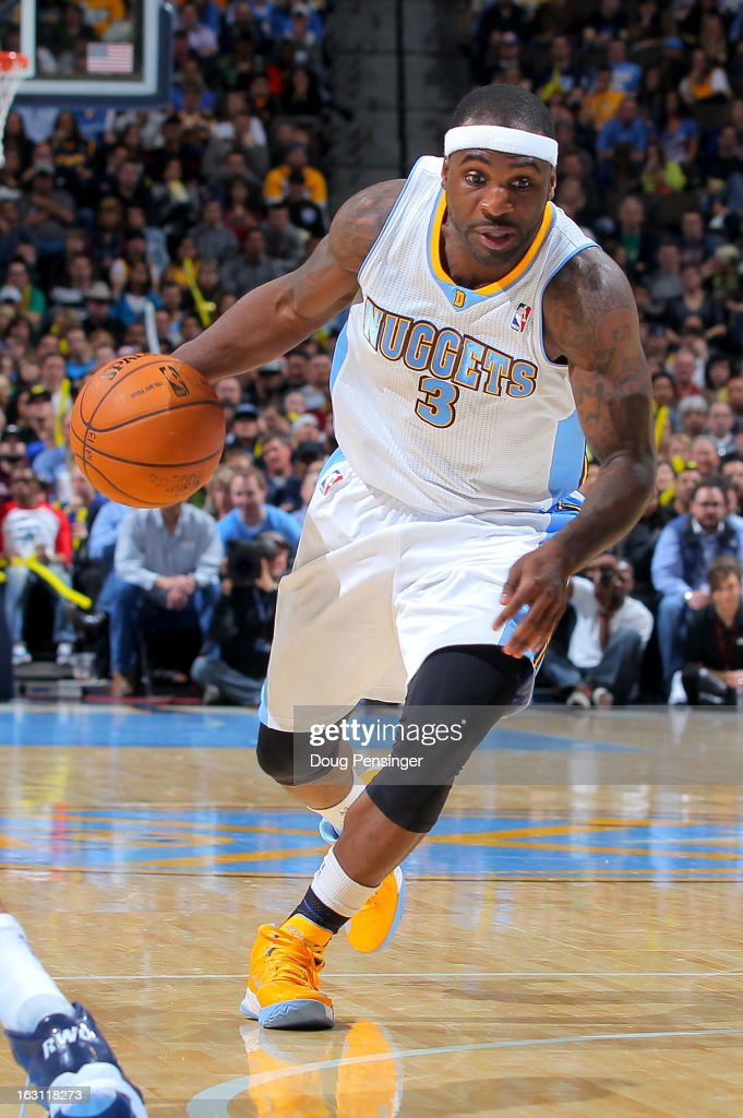 <a gi-track='captionPersonalityLinkClicked' href=/galleries/search?phrase=Ty+Lawson&family=editorial&specificpeople=4024882 ng-click='$event.stopPropagation()'>Ty Lawson</a> #3 of the Denver Nuggets controls the ball against the Oklahoma City Thunder at the Pepsi Center on March 1, 2013 in Denver, Colorado. The Nuggets defeated the Thunder 105-103.