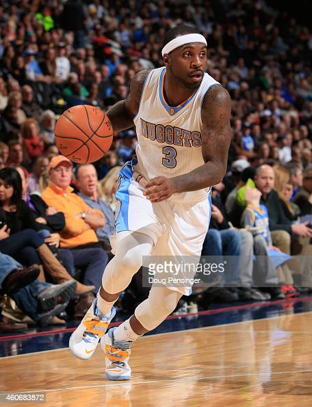 Ty Lawson of the Denver Nuggets controls the ball against the San Antonio Spurs at Pepsi Center on December 14 2014 in Denver Colorado The Spurs...