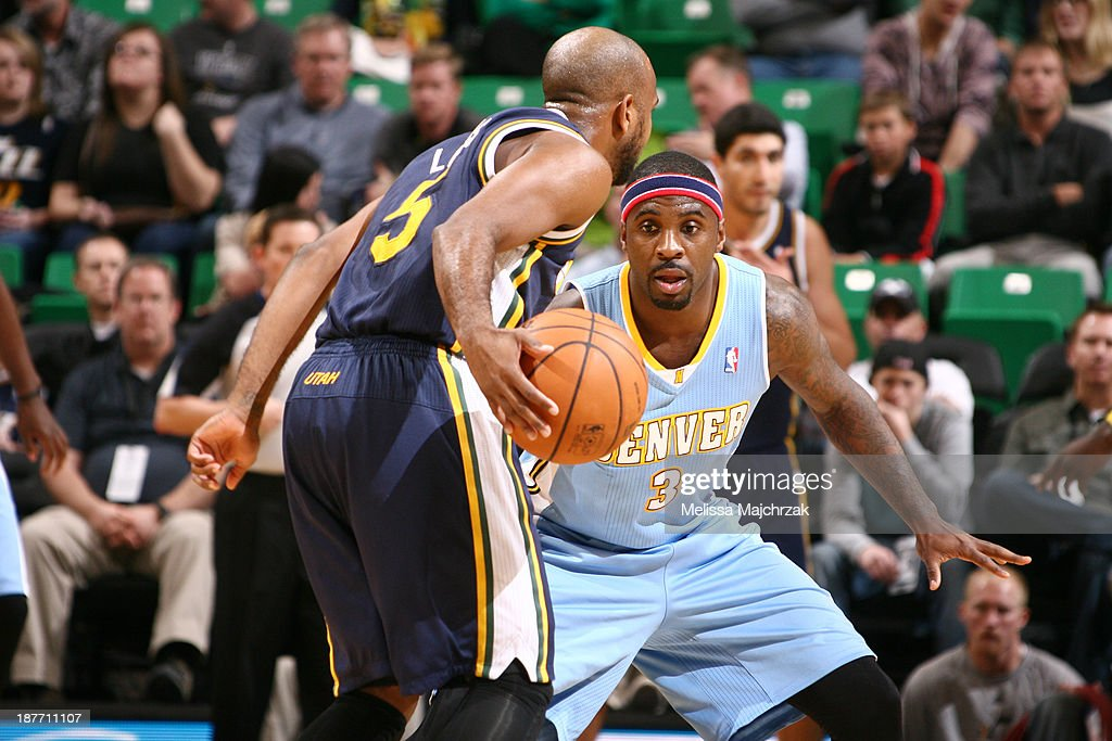 Ty Lawson #3 of the Denver Nuggets defends against John Lucas III #5 of the Utah Jazz at EnergySolutions Arena on November 11, 2013 in Salt Lake City, Utah.