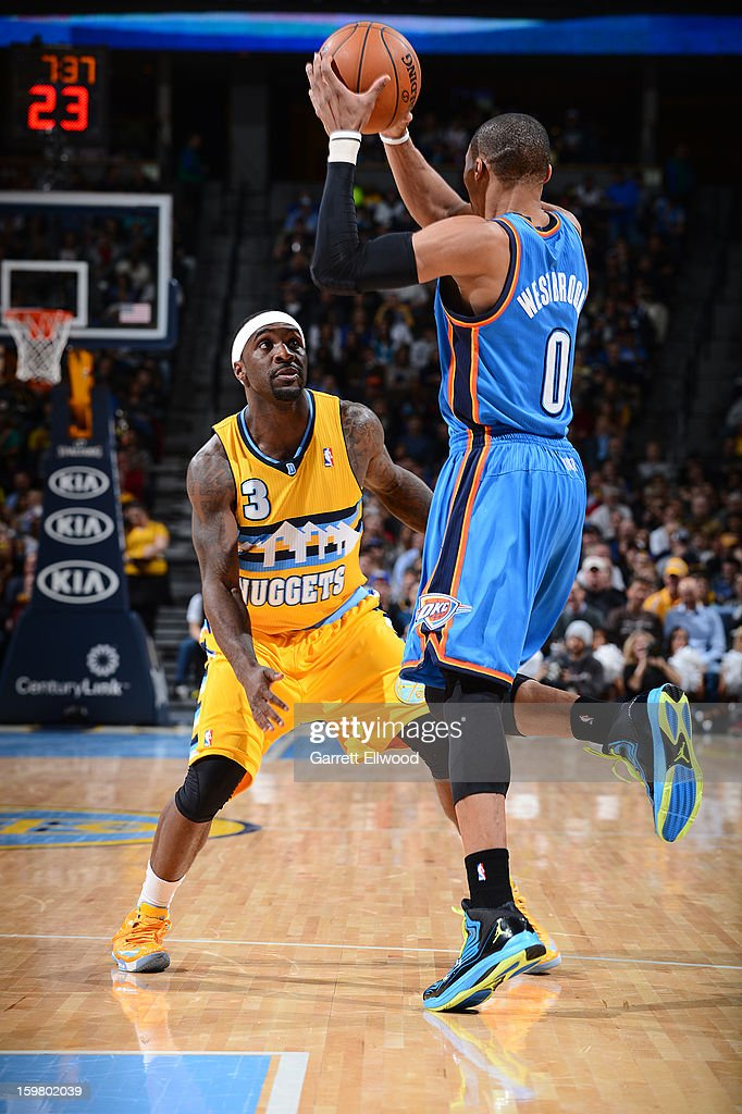 Ty Lawson #3 of the Denver Nuggets defends against Russell Westbrook #0 of the Oklahoma City Thunder on January 20, 2013 at the Pepsi Center in Denver, Colorado.