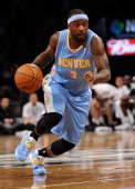 Ty Lawson of the Denver Nuggets dribbles against the Brooklyn Nets during the first half at Barclays Center on December 3 2013 in the Brooklyn...