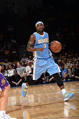 Ty Lawson of the Denver Nuggets dribbles down court against the Los Angeles Lakers as the Los Angeles Lakers take on the Denver Nuggets at the Valley...