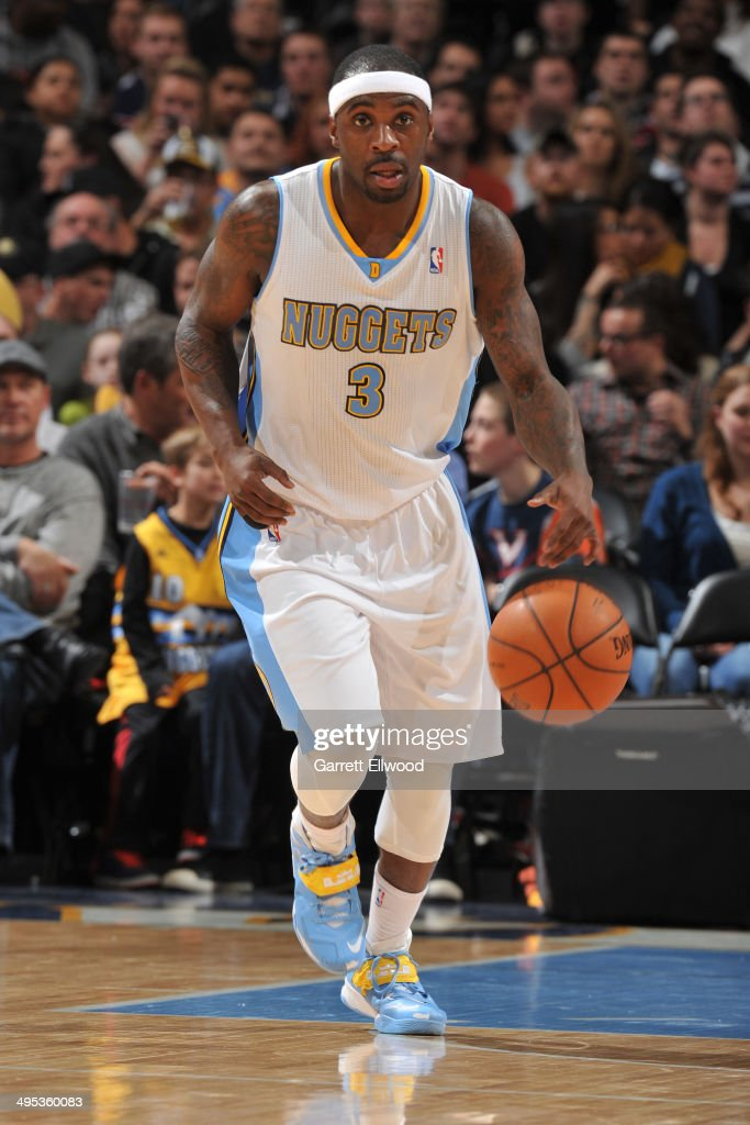 <a gi-track='captionPersonalityLinkClicked' href=/galleries/search?phrase=Ty+Lawson&family=editorial&specificpeople=4024882 ng-click='$event.stopPropagation()'>Ty Lawson</a> #3 of the Denver Nuggets dribbles the ball against the Milwaukee Bucks on February 5, 2014 at the Pepsi Center in Denver, Colorado.
