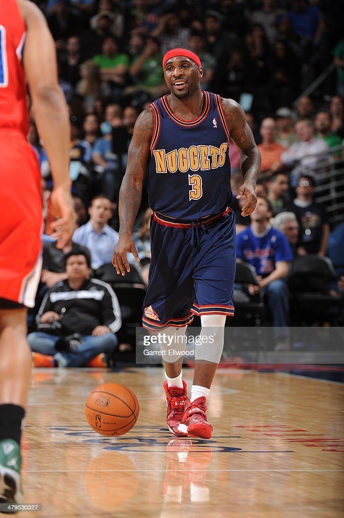 <a gi-track='captionPersonalityLinkClicked' href=/galleries/search?phrase=Ty+Lawson&family=editorial&specificpeople=4024882 ng-click='$event.stopPropagation()'>Ty Lawson</a> #3 of the Denver Nuggets dribbles the ball against the Los Angeles Clippers on March 17, 2014 at the Pepsi Center in Denver, Colorado.