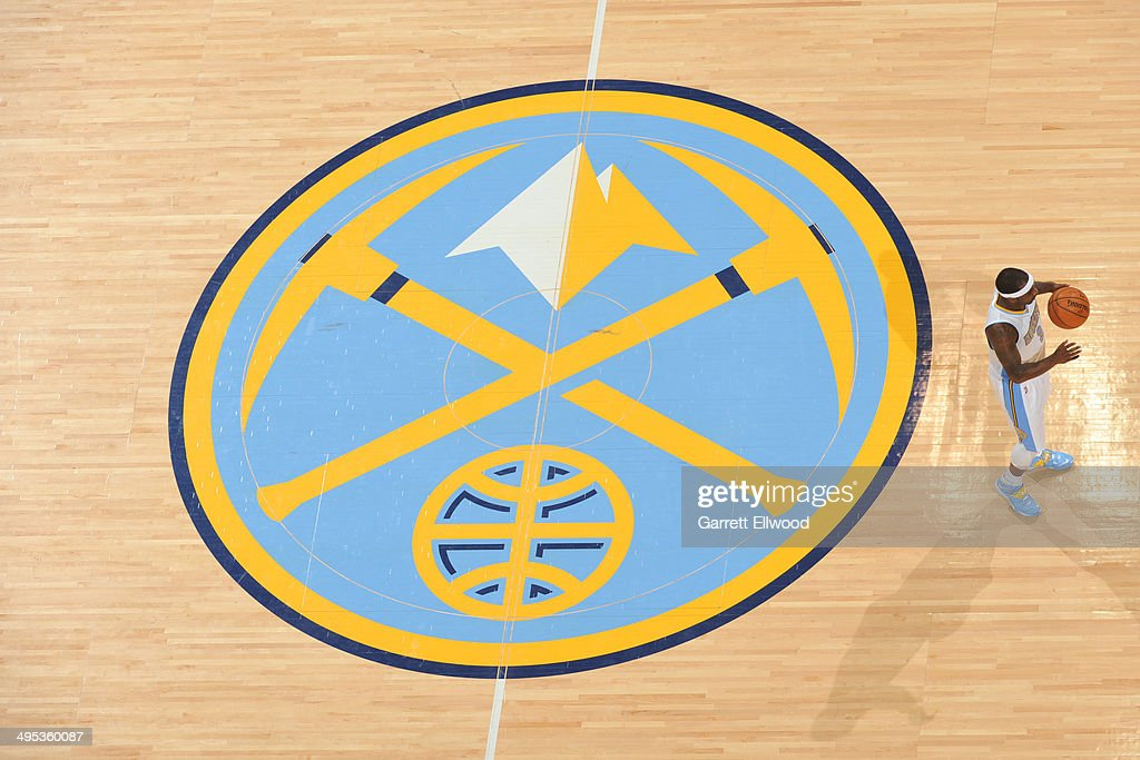 <a gi-track='captionPersonalityLinkClicked' href=/galleries/search?phrase=Ty+Lawson&family=editorial&specificpeople=4024882 ng-click='$event.stopPropagation()'>Ty Lawson</a> #3 of the Denver Nuggets dribbles the ball during the game against the Milwaukee Bucks on February 5, 2014 at the Pepsi Center in Denver, Colorado.