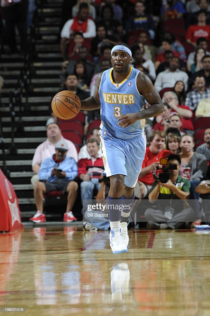 Ty Lawson #3 of the Denver Nuggets dribbles the ball up court against the Houston Rockets on November 7, 2012 at the Toyota Center in Houston, Texas.