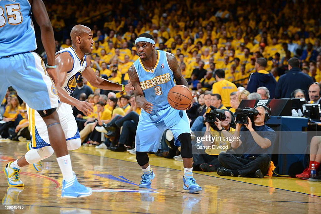 <a gi-track='captionPersonalityLinkClicked' href=/galleries/search?phrase=Ty+Lawson&family=editorial&specificpeople=4024882 ng-click='$event.stopPropagation()'>Ty Lawson</a> #3 of the Denver Nuggets drives against <a gi-track='captionPersonalityLinkClicked' href=/galleries/search?phrase=Jarrett+Jack&family=editorial&specificpeople=208109 ng-click='$event.stopPropagation()'>Jarrett Jack</a> #2 of the Golden State Warriors in Game Three of the Western Conference Quarterfinals during the 2013 NBA Playoffs on April 26, 2013 at the Oracle Arena in Oakland, California.