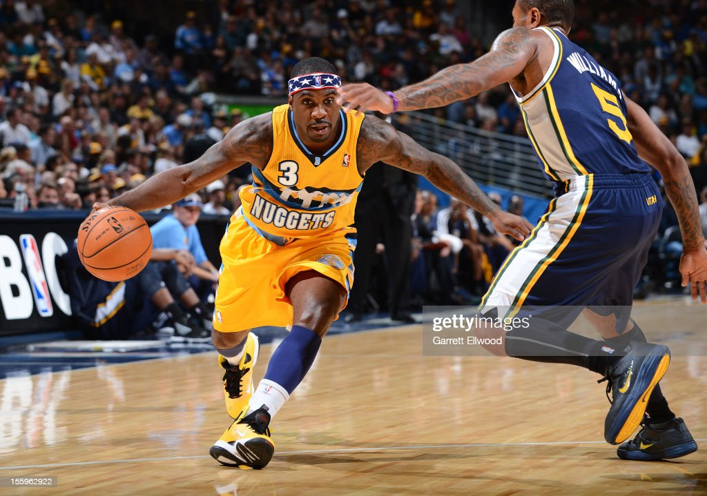 <a gi-track='captionPersonalityLinkClicked' href=/galleries/search?phrase=Ty+Lawson&family=editorial&specificpeople=4024882 ng-click='$event.stopPropagation()'>Ty Lawson</a> #3 of the Denver Nuggets drives against Mo Williams #5 of the Utah Jazz on November 9, 2012 at the Pepsi Center in Denver, Colorado.