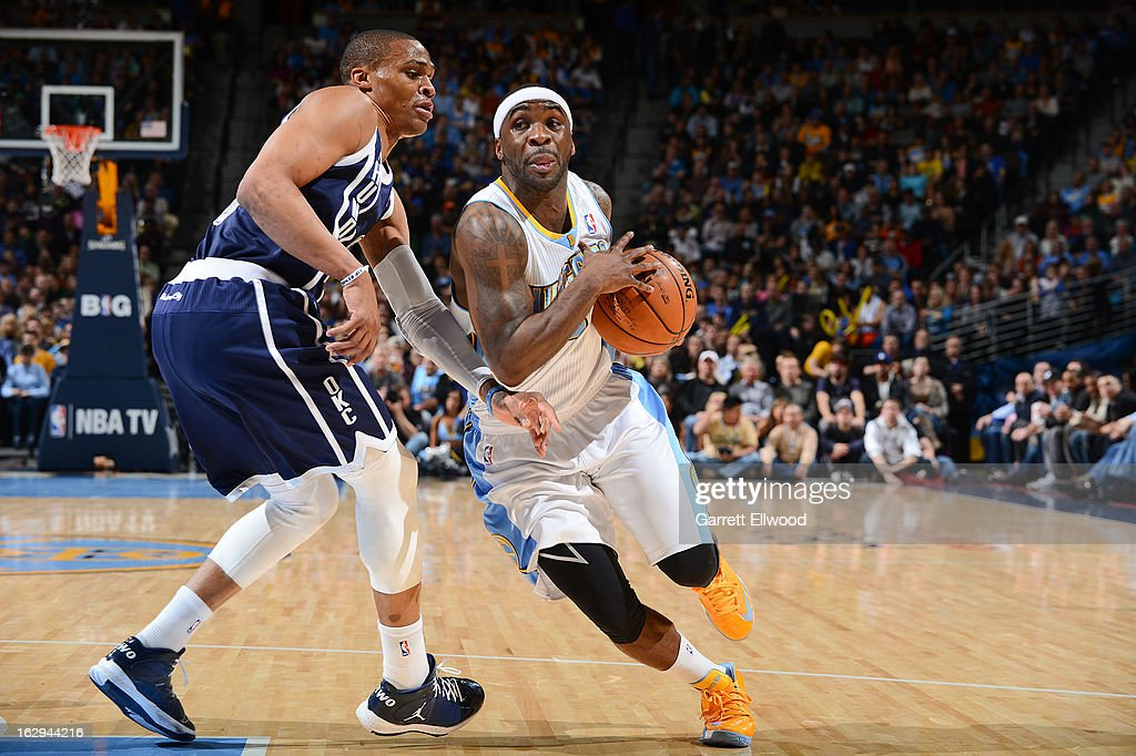 Ty Lawson #3 of the Denver Nuggets drives against Russell Westbrook #0 of the Oklahoma City Thunder on March 1, 2013 at the Pepsi Center in Denver, Colorado.