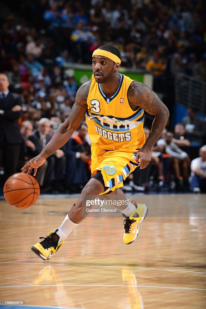 Ty Lawson #3 of the Denver Nuggets drives against the Charlotte Bobcats on December 22, 2012 at the Pepsi Center in Denver, Colorado.