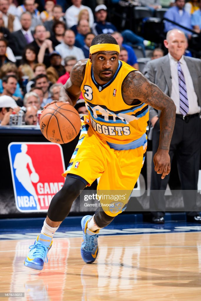 <a gi-track='captionPersonalityLinkClicked' href=/galleries/search?phrase=Ty+Lawson&family=editorial&specificpeople=4024882 ng-click='$event.stopPropagation()'>Ty Lawson</a> #3 of the Denver Nuggets drives against the Golden State Warriors in Game Two of the Western Conference Quarterfinals during the 2013 NBA Playoffs on April 23, 2013 at the Pepsi Center in Denver, Colorado.