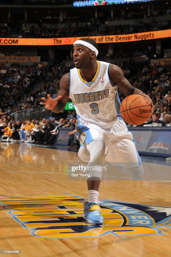 Ty Lawson #3 of the Denver Nuggets drives against the Milwaukee Bucks on February 5, 2014 at the Pepsi Center in Denver, Colorado.